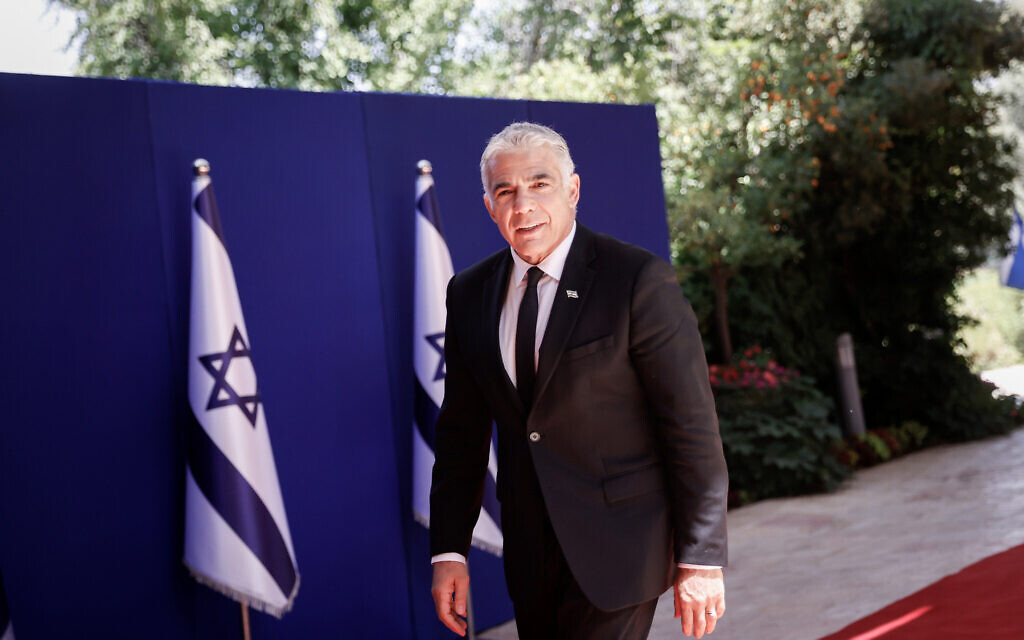 Foreign Minister Yair Lapid arrives at the president's residence in Jerusalem for a group photo of the new government, June 14, 2021. (Yonatan Sindel/FLASH90)