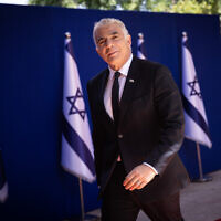 Foreign Minister Yair Lapid arrives to the President's Residence in Jerusalem, for a group photo of the newly sworn in Israeli government, June 14, 2021.(Yonatan Sindel/Flash90)