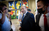 Prime Minister Naftali Bennett arrives for a group photo of the new government, at the president's residence in Jerusalem on June 14, 2021. (Yonatan Sindel/FLASH90)