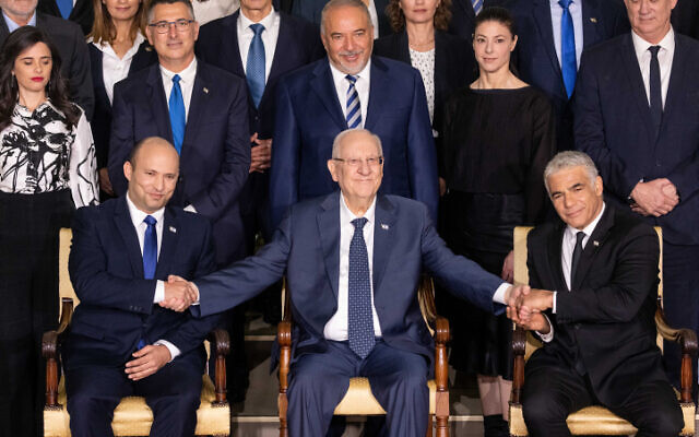 The newly sworn in Israeli government poses for a group photo at the President's Residence in Jerusalem on June 14, 2021 (Yonatan Sindel/Flash90)