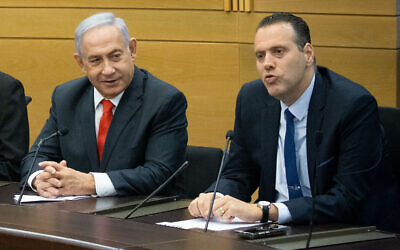 Former prime minister Benjamin Netanyahu (L) and Likud MK Miki Zohar at a meeting of opposition parties in Netanyahu's right wing-religious bloc, at the Knesset in Jerusalem, on June 14, 2021. (Yonatan Sindel/Flash90)