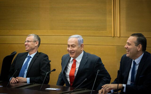 From left to right: MK Yariv Levin, Likud  leader Benjamin Netanyahu and MK Miki Zohar at the Knesset on June 14, 2021. (Yonatan Sindel/Flash90)