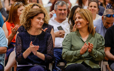 Newly appointed Minister of Environmental Protection Tamar Zandberg (right) with outgoing Minister of Environmental Protection Gila Gamliel (eft), during the handover ceremony, held at the Environmental Protection Ministry in Jerusalem on June 15, 2021. (Olivier Fitoussi/Flash90)