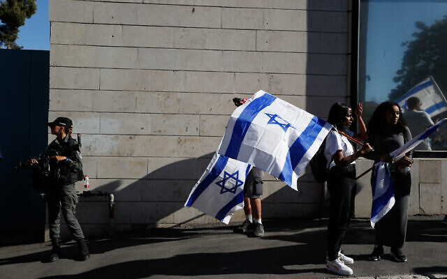 People with Israeli flags during the March of Flags near Jerusalem's Old City, June 15, 2021. (Yonatan Sindel/Flash90)