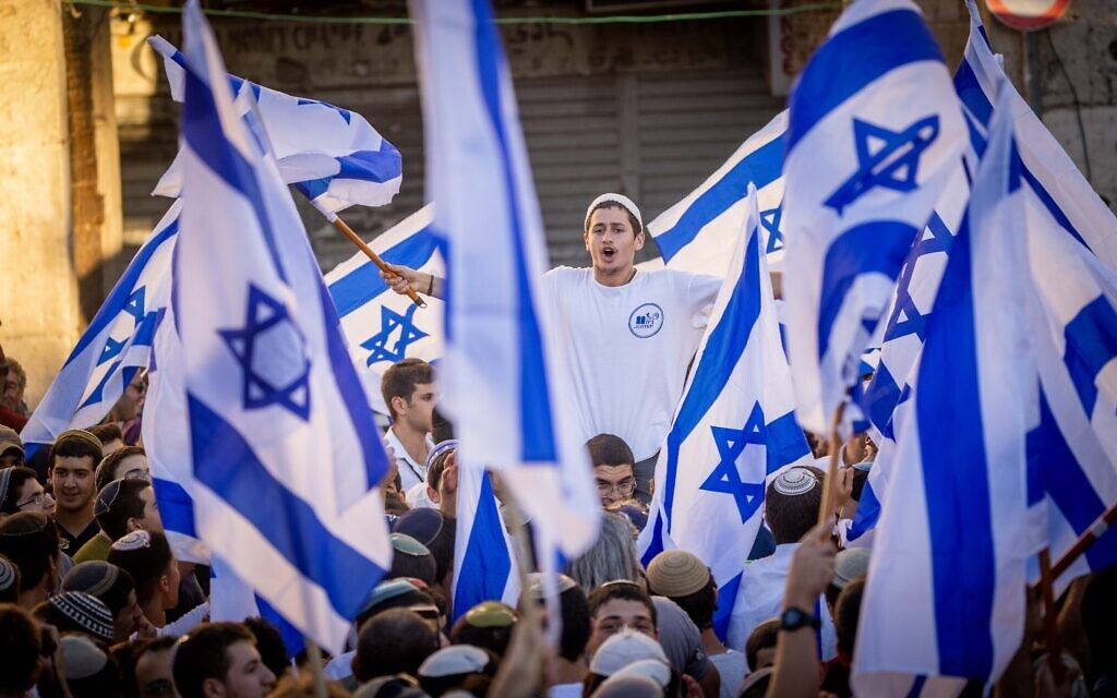 Nationalist Israeli Jews wave flags and dance at the Damascus Gate in Jerusalem's Old City, June 15, 2021. (Yonatan Sindel/Flash90)