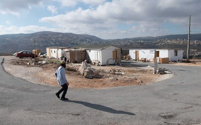 Settlers seen in the Illegal Evyatar outpost, in the northern West Bank, on June 16, 2021. (Sraya Diamant/Flash90)