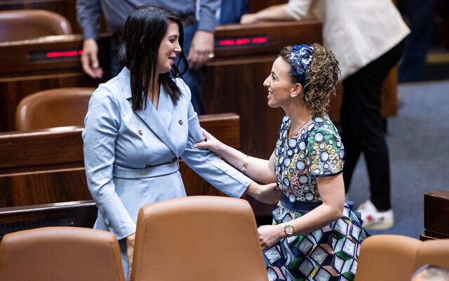 Shirley Pinto, the first deaf Knesset member, with fellow Yamina MK Idit Silman during a swearing-in ceremony of new Israeli parliament members at the Knesset on June 16, 2021. (Yonatan Sindel/Flash90)