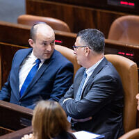 Prime Minister Naftali Bennett with Minister of Justice Gideon Saar during a swearing in ceremony of new Israeli parliament members at the Knesset, the Israeli parliament in Jerusalem, June 16, 2021.(Yonatan Sindel/Flash90)