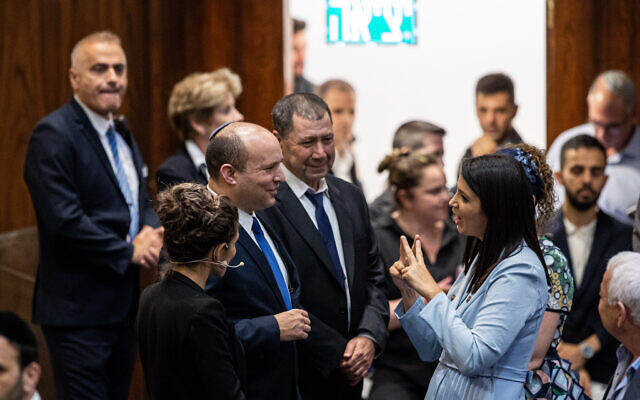Shirley Pinto, the first deaf Knesset member, with Prime Minister Naftali Bennett and other MKs during a swearing-in ceremony of new Israeli parliament members at the Knesset, June 16, 2021. (Yonatan Sindel/Flash90)