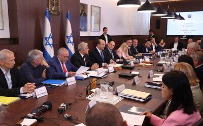 Prime Minister Naftali Bennett (5th left) leads his first cabinet meeting at the Prime Minister's Office in Jerusalem on June 20, 2021.  (Amit Shabi/POOL)