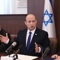 Prime Minister Naftali Bennett (C) leads a cabinet meeting at the Prime Minister's Office in Jerusalem, June 20, 2021. (Amit Shabi/POOL)