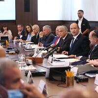 Prime Minister Naftali Bennett (facing camera) leads a cabinet meeting at the Prime Minister's Office in Jerusalem, June 20, 2021. (Amit Shabi/POOL)