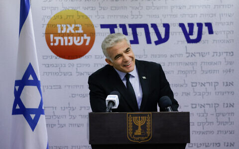 Yair Lapid speaks during a faction meeting at the Knesset on June 21, 2021. (Olivier Fitoussi/Flash90)