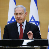 Former prime minister Benjamin Netanyahu and head of the Likud party leads a faction meeting in the Israeli parliament on June 21, 2021. (Olivier Fitoussi/FLASH90)