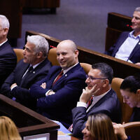 Foreign Minister Yair Lapid (L) with Prime  Minister Naftali Bennett (2L) and Justice Minister Gideon Sa'ar (2R) in the assembly hall of the Israeli parliament on June 21, 2021. (Olivier Fitoussi/FLASH90)