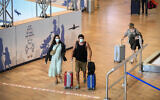 Arriving travelers at Ben Gurion International Airport,on June 23, 2021. (Flash90)
