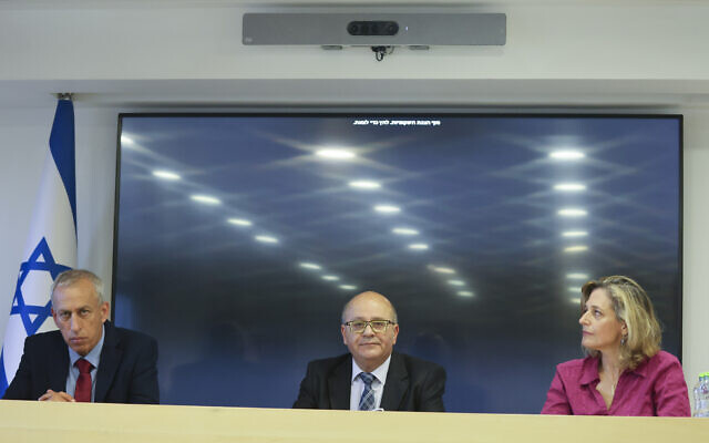 From left to right: National coronavirus czar Nachman Ash, Health Ministry director-general Chezy Levy and Sharon Alroy-Preis, the ministry's head of public health, at a press conference in Jerusalem on June 23, 2021.(Yonatan Sindel/Flash90)
