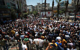 Palestinians take part in a protest following the death of Palestinian human rights activist Nizar Banat, who died a short time after being arrested by Palestinian Authority officials, in the West Bank city of Ramallah, on June 24, 2021. (Flash90)