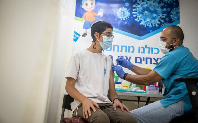An Israeli receives a COVID-19 vaccine at a Clalit vaccination center in Jerusalem on June 24, 2021. (Yonatan Sindel/Flash90)