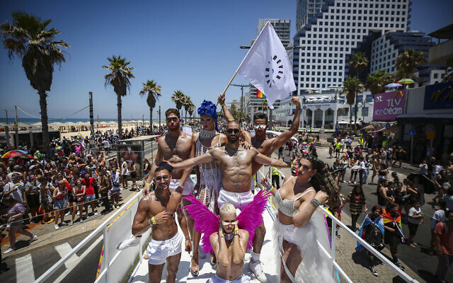 People participate at the annual Gay Pride Parade in Tel Aviv, on June 25, 2021. (Miriam Alster/Flash90)