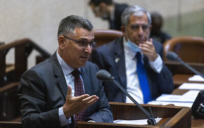 Justice Minister Gideon Sa'ar (L) and Knesset Speaker Mickey Levy (R) at a plenary session at the assembly of the Knesset in Jerusalem, June 28, 2021 (Olivier Fitoussi/Flash90)