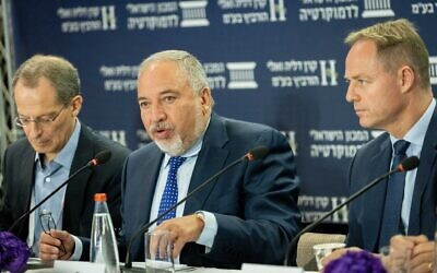 Finance Minister Avigdor Liberman (center) attends the Eli Horowitz Conference for Economy and Society, organized by the Israel Democracy Institute, in Jerusalem on June 29, 2021. (Yonatan Sindel/Flash90)