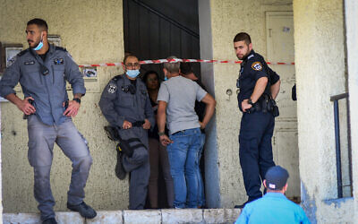 Police at the scene where a woman was shot dead in her apartment in Haifa, June 30, 2021. (Omri Stein/Flash90)