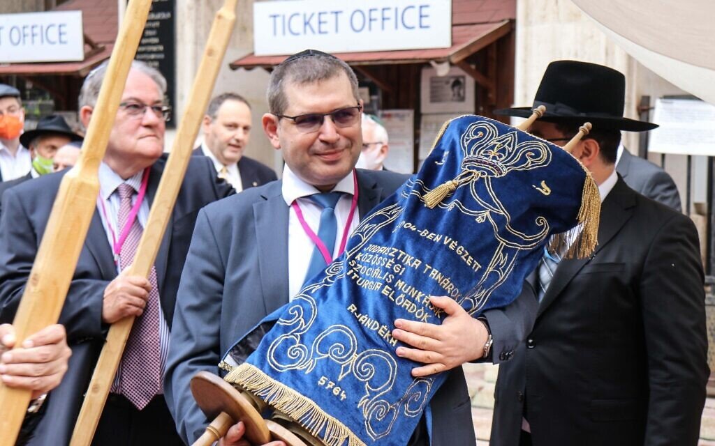 Members of the Budapest Jewish community dance with the Torah at the reopening ceremony of the Rumbach Synagogue, June 10, 2021. (Photo by Akos Szentgyorgyi)