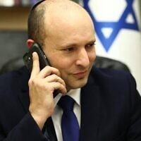 Prime Minister Naftali Bennett speaks to US President Joe Biden, on June 13, 2021. (Courtesy: Ariel Zandberg)