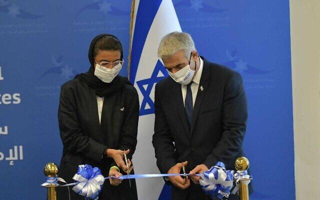 Foreign Minister Yair Lapid (R) and Emirati Culture Minister Noura Al Kaabi inaugurate the Israeli embassy in Abu Dhabi, June 29, 2021. (Shlomi Amsalem/GPO)