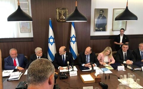 Prime Minister Naftali Bennett (third left) at the government's first cabinet meeting, at the Prime Minister's Office in Jerusalem, June 20, 2021. (Tal Schneider/Times of Israel)