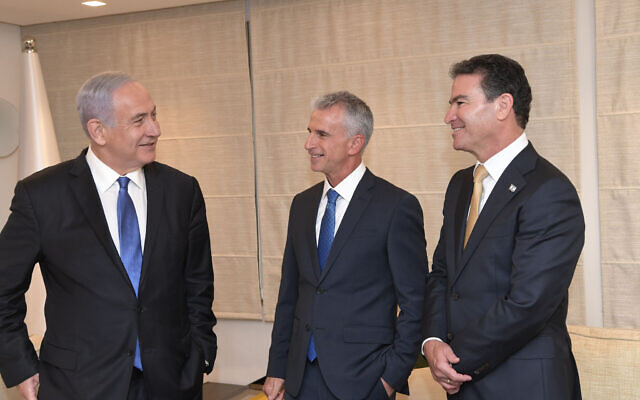 Prime Minister Benjamin Netanyahu, left, new Shin Bet chief David Barnea, center, and Yossi Cohen, at a farewell ceremony for departing Shin Bet chief Cohen, on May 31, 2021. (Kobi Gideon / GPO)