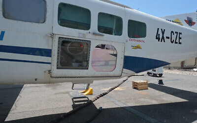A high-powered laser system installed on a Cessna aircraft as part of a test of the system by the Defense Ministry and Elbit Systems weapons contractor in June 2021. (Defense Ministry)