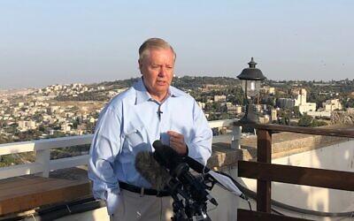 Senator Lindsey Graham (R-SC) speaks to reporters on the roof of Jerusalem's King David Hotel, June 1, 2021 (Lazar Berman/Time of Israel)