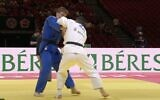 Screen capture from video of Iranian dissident judoka Saeid Mollaei, in white, competing for Mongolia during a bout against Israeli Din Yaacov Gemer during the World Judo Championships in Hungary, June 8, 2021. (YouTube)