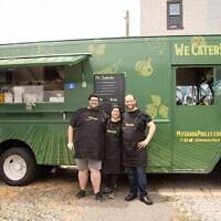 Chef Nir Sheynfeld, right, with colleagues at the Moshava food truck. (Moshava/Instagram)