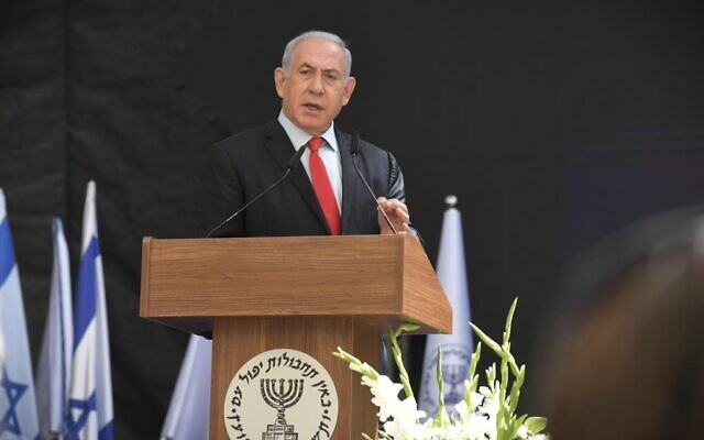Prime Minister Benjamin Netanyahu addressing a ceremony to hand over control of the Mossad intelligence agency from outgoing director Yossi Cohen to his replacement David Barnea, June 1, 2021. (Koby Gideon/GPO)
