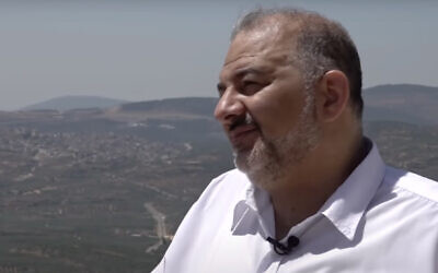 Ra'am leader Mansour Abbas speaks to the Kan public broadcaster during an interview from his home in the northern town of Maghar on June 3, 2021. (Screen capture: YouTube)