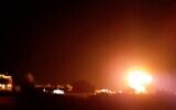 A fireball light up the night sky above buildings near Khan Younis in southern Gaza, as IDF planes hit a Hamas site in the Palestinian enclave, on June 17, 2021. (Screen capture)