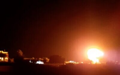 A fireball lights up the night sky above buildings near Khan Younis in southern Gaza, as IDF planes hit a Hamas site in the Palestinian enclave, on June 17, 2021. (Screen capture)
