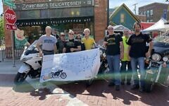 Steve Goode, far left, is biking across America to raise awareness about hunger by visiting Jewish delis. (Courtesy Goode/ via JTA)
