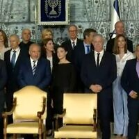 New ministers prepare for a traditional government photo with the president at Reuven Rivlin's official residence in Jerusalem, June 14, 2021. (Screenshot: Channel 12)