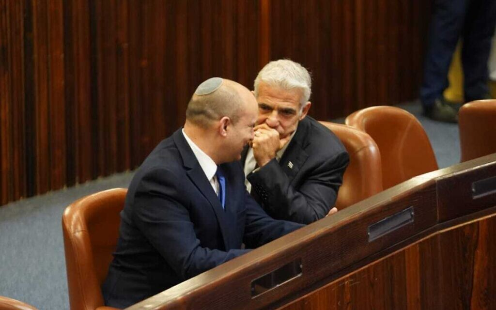 Yesh Atid chairman Yair Lapid (R) and Yamina head Naftali Bennett in the Knesset plenum for the election of Israel's 11th president, June 2, 2021. (Dani Shem Tov/ Knesset)