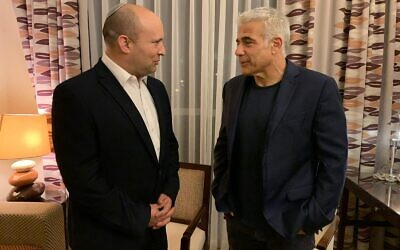 Yamina chief Naftali Bennett and Yesh Atid leader Yair Lapid are seen on Wednesday evening, as they inform President Reuven Rivlin they have succeeded in forming a government, June 2, 2021. (Courtesy)