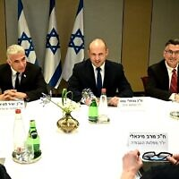 (L-R) Yesh Atid leader Yair Lapid, Yamina chair Naftali Bennett and New Hope head Gideon Sa'ar at a meeting of the heads of the would-be-coalition in Tel Aviv, June 6, 2021. (Ra'anan Cohen)