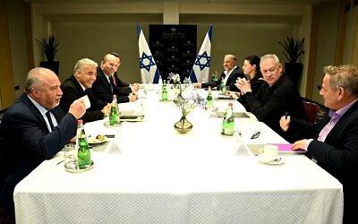 (L-R) Yisrael Beytenu leader Avigdor Liberman, Yesh Atid leader Yair Lapid, Yamina chair Naftali Bennett, New Hope chair Gideon Sa'ar, Blue and White head Benny Gantz, Ra'am chair Mansour Abbas, Labor head Merav Michaeli and Meretz leader Nitzan Horowitz at a meeting of the heads of the would-be-coalition in Tel Aviv, June 6, 2021. (Ra'anan Cohen)