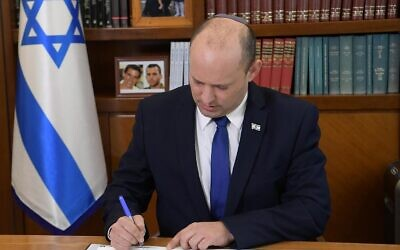 Prime Minister Naftali Bennett at the Prime Minister's Office on the first day of the job in Jerusalem on June 14, 2021. (Amos Ben Gershom/GPO)