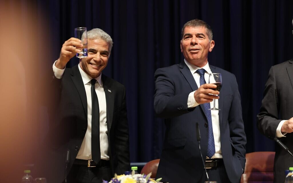 Newly appointed Foreign Minister Yair Lapid (L) with outgoing minister Gabi Ashkenazi, at handover ceremony held at the Foreign Ministry in Jerusalem on June 14, 2021. (Foreign Ministry)