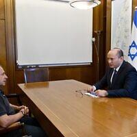 Prime Minister Naftali Bennett (right) and Shin Bet chief Nadav Argaman meet at the Prime Minister's Office in Jerusalem on June 15, 2021. (Haim Tzach/GPO)