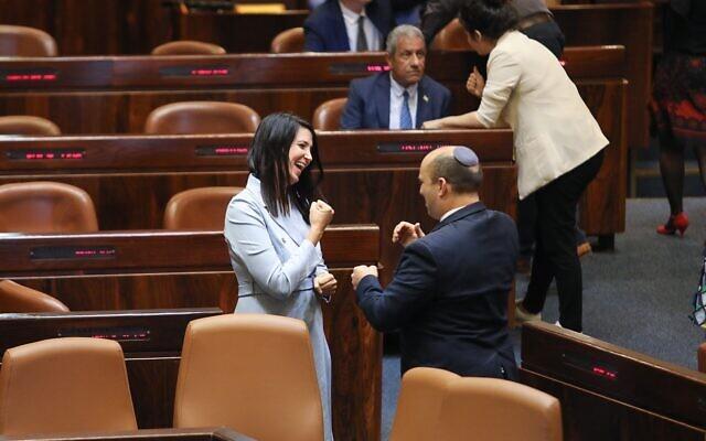 Prime Minister Naftali Bennett and Yamina MK Shirley Pinto communicate via sign language on the Knesset floor on June 16, 2021. (Noam Moskowitz/Knesset)